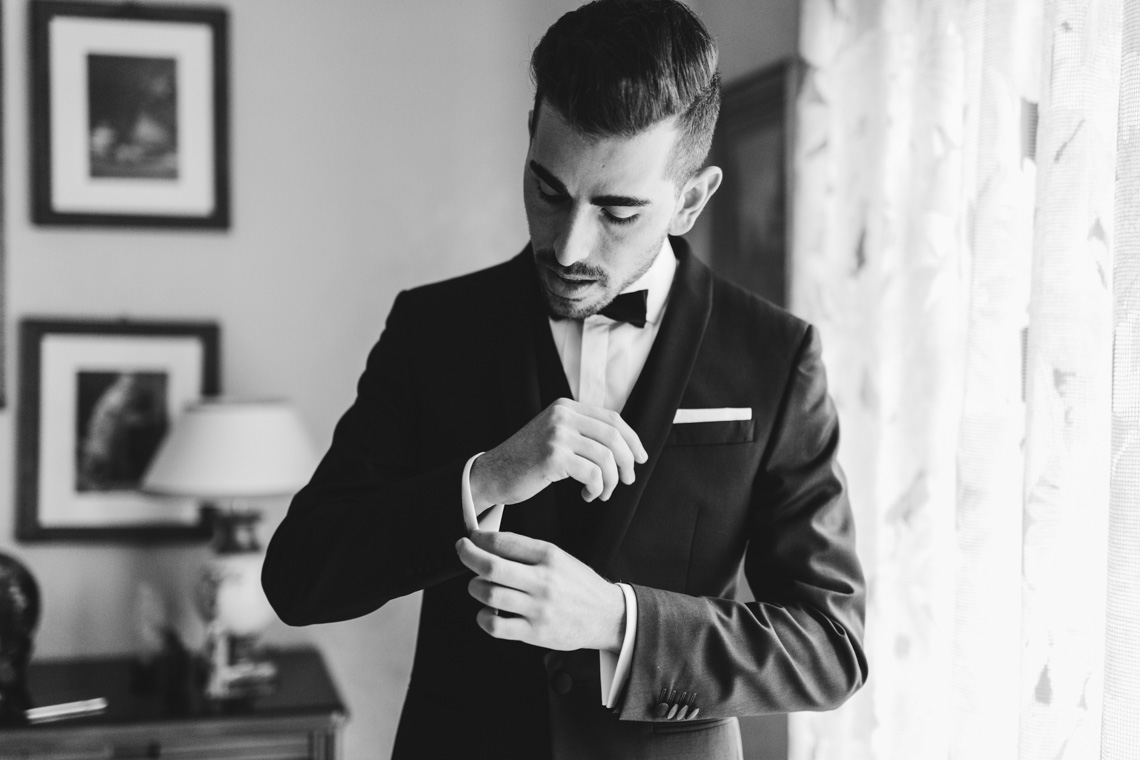 man smoking groom photographed